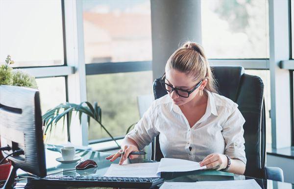 company secretarial photo via women working in office