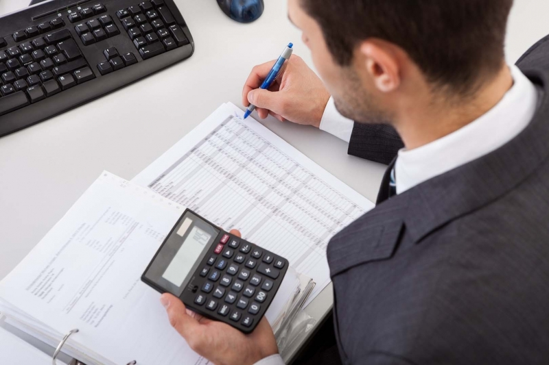 tax outsourcing photo via ma working in office on accountants